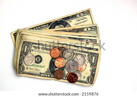 Some dollor bills and change on a white background - stock photo