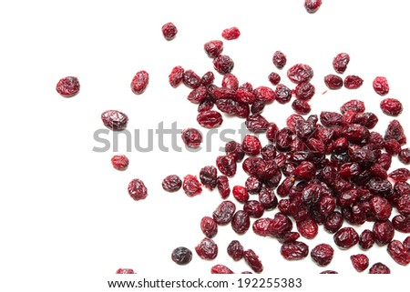 Some dried cranberries isolated on white. - stock photo