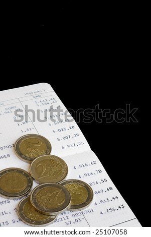 Some Euro coins on a book savings - stock photo