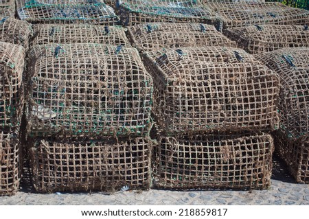 Some fishing cages stacked on the ground - stock photo
