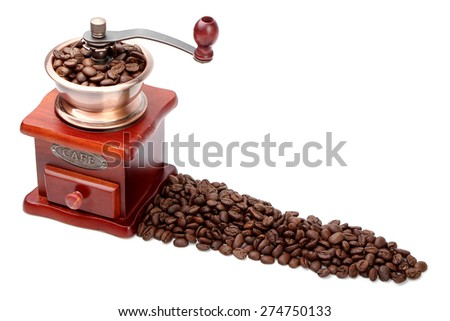 Some fresh coffee bean in coffee bean grinder is next to coffee bean isolated on white background. - stock photo