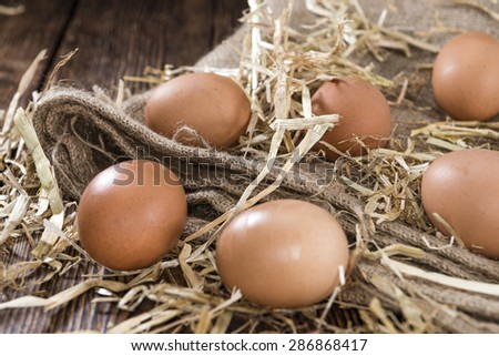 Some fresh Eggs (close-up shot) on dark wooden background - stock photo