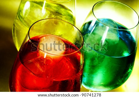 some glasses with cocktails of different colors in a club - stock photo