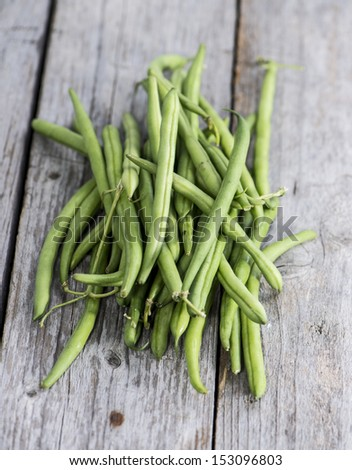 Some Green Beans on wooden background - stock photo