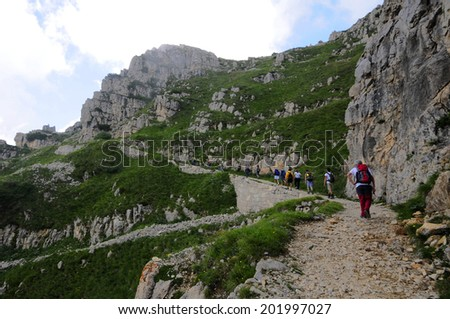 Some guys walking in a mountain scene  - stock photo