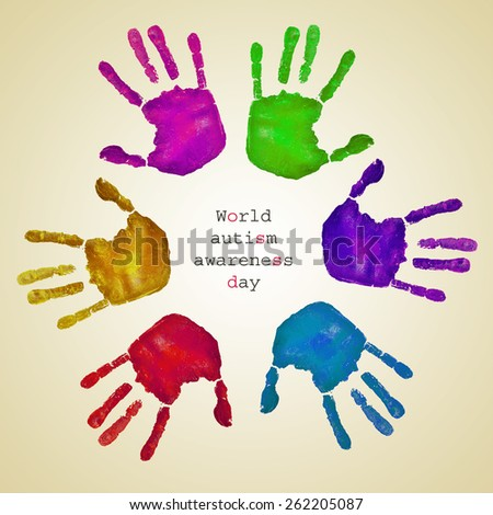 some handprints of different colors forming a circle on a beige background and the text world autism awareness day written inside - stock photo