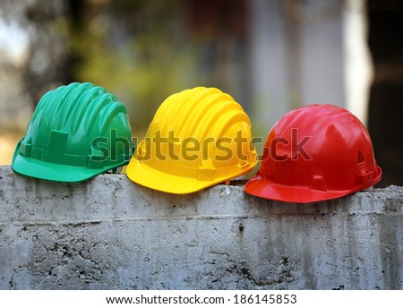Some helmets close up on work place  - stock photo
