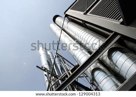 Some industrial metal pipes of a ventilation system. - stock photo