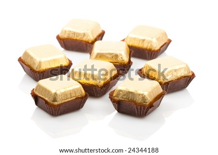 some isolated candies on white background with reflection - stock photo