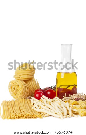 Some kinds of the Italian pasta, bottle of olive oil and tomatoes on a white background. A shot vertical, focus in the shot center. - stock photo