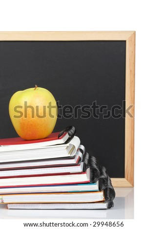 Some notebooks and yellow apple. Shallow depth of field - stock photo