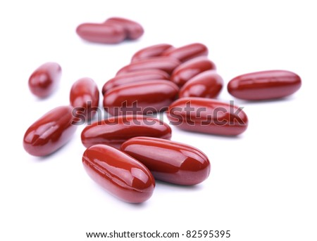 Some of brown pills isolated on a white background. Shallow DOF - stock photo
