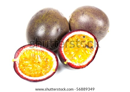 Some passion fruit with one cut in half - stock photo