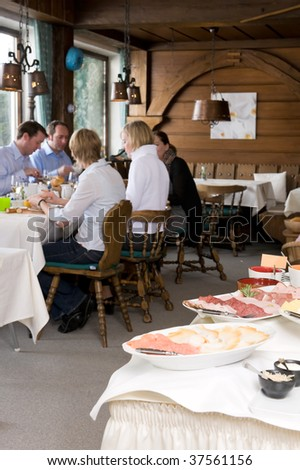 Some people having a  breakfast in a small hotel - stock photo