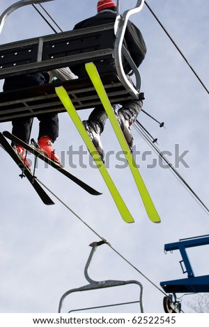Some people ride the chair lift to the top of the mountain so they can ski back down. - stock photo