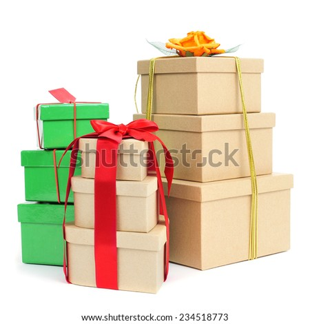 some piles of gift boxes of different colors and sizes on a white background - stock photo