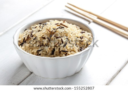 some raw thai rice on a bowl - stock photo