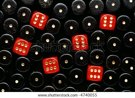 some red dices showing six between black dices showing one - stock photo