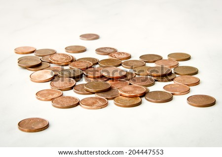 Some shiny one euro cent coins on a pile isolated on a white background. - stock photo