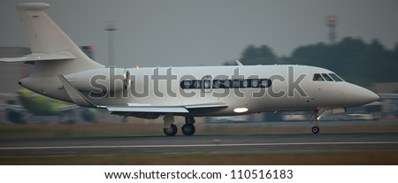 some small jet landing with speed blur - stock photo