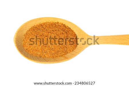 some spices on a wooden spoon. isolated on a white background - stock photo