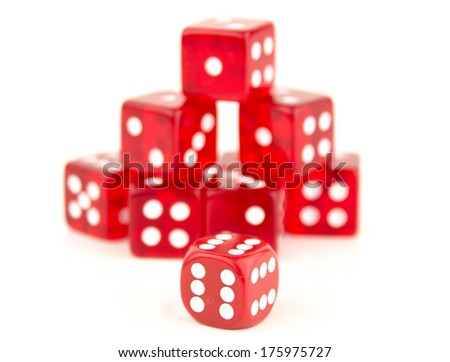some stacked red dice behind a 666, Cheating or reducing the odds ? - stock photo
