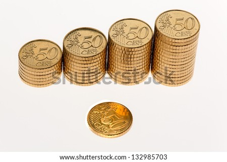 some stacks of euro coins on a white background - stock photo