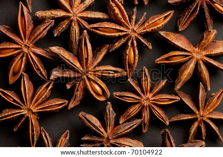some star shaped anis forming a background pattern - stock photo
