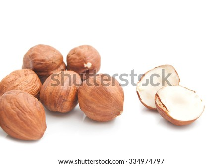 some tasty hazelnuts closeup on white background  - stock photo