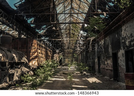 Some trains at abandoned train depot - stock photo