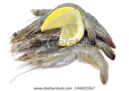 some uncooked tiger prawns on a white background - stock photo