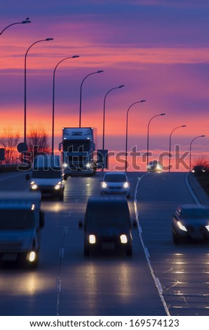 Some vehicles in motion in an spanish road - stock photo