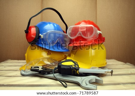 Some worker's helmets close up. Safety concept - stock photo