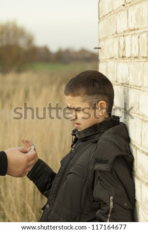 Somebody offers the syringe with the drug dose - stock photo