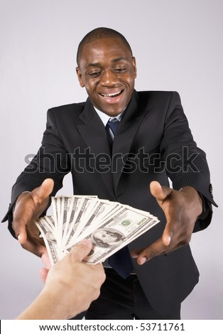 Someone giving many banknotes to an african business man - stock photo