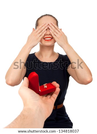 Someone making proposal to a woman - stock photo