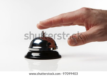 someone's hand pressing a service bell what could they want - stock photo