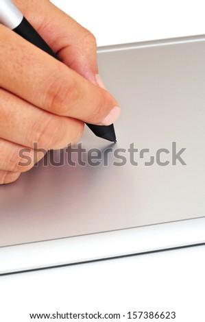 someone using a stylus in a graphics tablet - stock photo