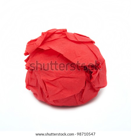 Something round is turned in a red paper - stock photo