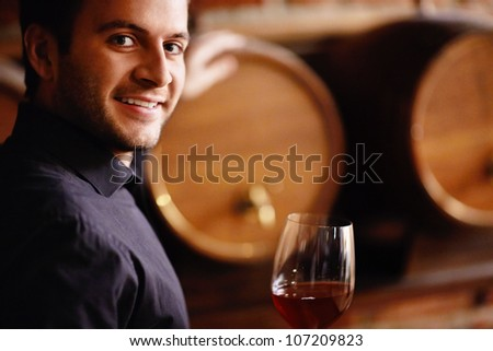 Sommelier and wine from the barrel - stock photo