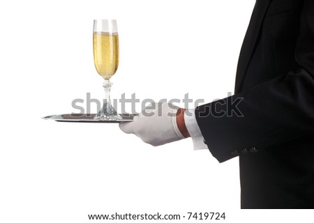 Sommelier in Tuxedo Serving Champagne Glass on a silver tray isolated over white. Man is unrecognizable.  - stock photo