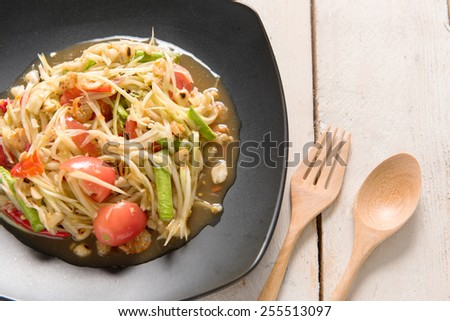 Somtum Thai food on wooden table. - stock photo