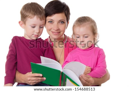 Son and daughter listening their mother reading book isolated on white - stock photo