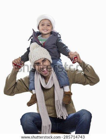 Son and father in playful mood - stock photo