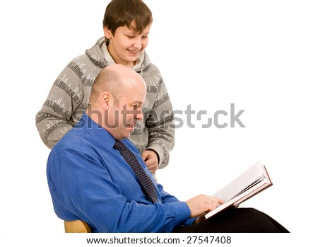 son and father with book on a white background - stock photo