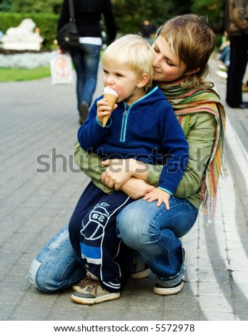 Son eating ice cream - stock photo
