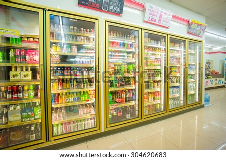Songkhla, 30 june 2015: 7-Eleven shop with interior of soft drinks shelves in fridges in Ra Not town, Songkhla province, Thailand. - stock photo