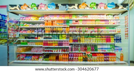Songkhla, 30 june 2015: 7-Eleven shop with interior of soft drinks shelves in Ra Not town, Songkhla province, Thailand. - stock photo