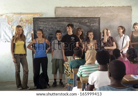 SONGRETENGA, BURKINA FASO - FEBRUARY 26: Visit of French schoolboy in Africa at the school of Songretenga. The French pupils present themselves to the pupils of Songretenga, February 26, 2007 - stock photo