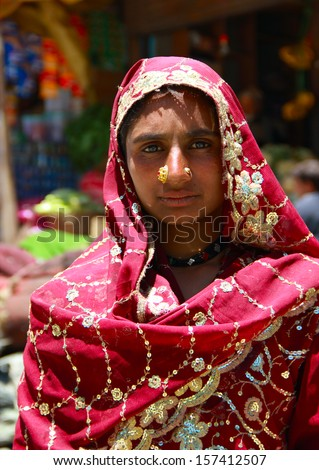 SONMARG/INDIA - JUNE 21: Unidentified tribe woman poses for photo on June 21, 2013 in Sonmarg, Ladakh, India. Dard is a group of people inhabit a mountain regions in Pakistan, Afghanistan and Kashmir  - stock photo